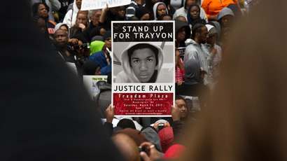 People hold signs during a demonstration in Washington in this March 24, 2012 file photo to demand justice for Trayvon Martin (AFP Photo / Nicholas Kamm / Files)