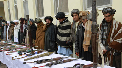 Afghan Taliban hand over their weapons as they join the Afghan government's reconciliation and reintegration program in Herat province, February 17, 2013. (Reuters/Mohmmad Shoib)