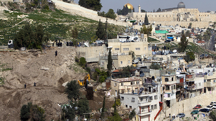 An Israeli army bulldozer destroys Palestinian houses in the east Jerusalem Arab neighbourhood of Silwan in JerusalemТs old city on January 28, 2013. (AFP Photo / Ahmad Gharabli)