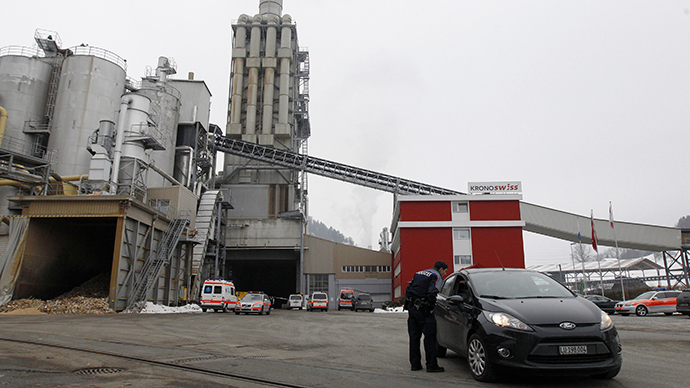 Police and rescue service vehicles are seen in front of the wood processing plant of Kronospan following a shooting in Menznau near Lucerne February 27, 2013. (Reuters / Michael Buholzer)