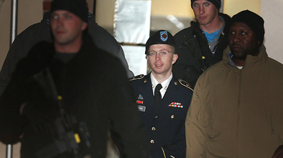 Bradley E. Manning is escorted from a hearing. (AFP Photo / Mark Wilson)