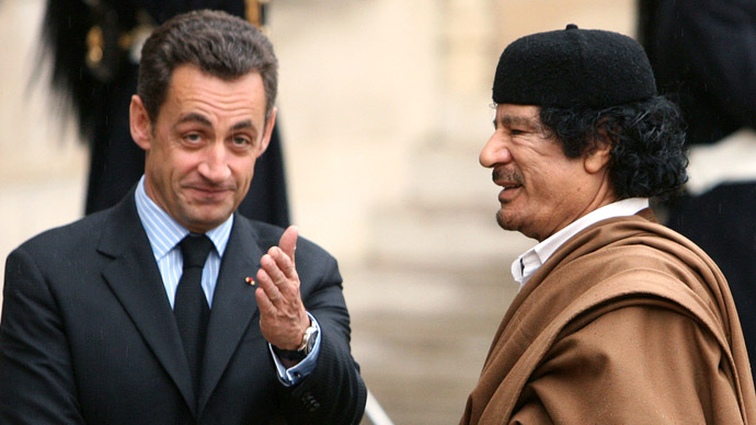 Nicolas Sarkozy greets Muammar Gaddafi in the courtyard of the Elysee Palace in Paris as he arrives for a five day official visit December 10, 2007. (Reuters/Jacky Naegelen)