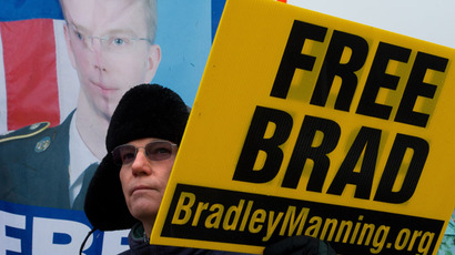 A protesters from the Bradley Manning Support Group holds a sign during a rally at the entrance of Fort George G. Meade military base in Fort Meade, Maryland on November 27, 2012. (AFP Photo/Mladen Antonov)