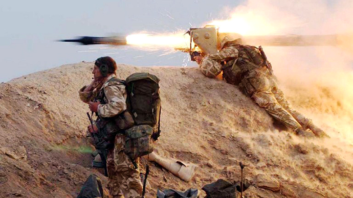 A photo issued 23 March 2003 of a British Royal Marine from 42 Commando squadron firing a Milan wire-guided missile at an Iraqi position on the Fao peninsula 21 March 2003. (AFP Photo / John Mills)
