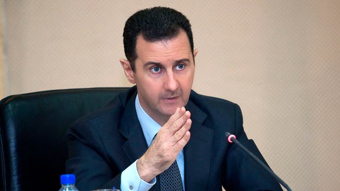 Bashar al-Assad heading a cabinet (AFP Photo / HO / SANA)