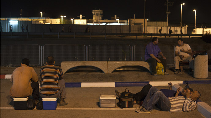 Palestinian labourers wait for work after crossing through Israel's Eyal checkpoint from the West Bank town of Qalqilya (Reuters/Nir Elia)