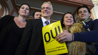 "Swiss businessman and senator Thomas Minder (3rdR) pose on March 3, 2013 with members of the support committee behind a poster reading ""Yes"" in French while waiting for the result of a nationwide vote in Schaffhausen.  (AFP Photo/Fabrice Coffrini)"