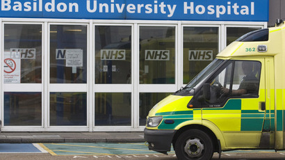 An ambulance drives past Basildon hospital in Essex, east of London (Reuters/Andrew Winning)