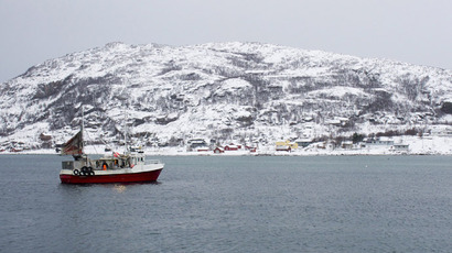 A fishing boat returns from a trip to the Barents Sea to the tiny port of Sommaroya, north Norway (Reuters/Alister Doyle)