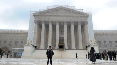 The front of the US Supreme Court is covered with an large banner printed with an image of the building during a restoration project on February 27, 2013 in Washington, DC. (AFP Photo)