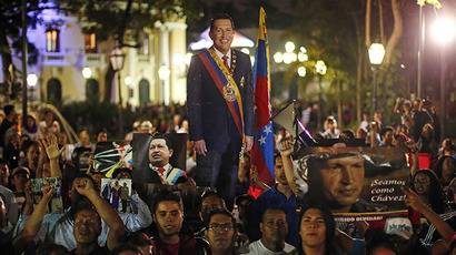 Supporters of Venezuela's President Hugo Chavez react to the announcement of his death in Caracas, March 5, 2013. (Reuters / Jorge Silva)