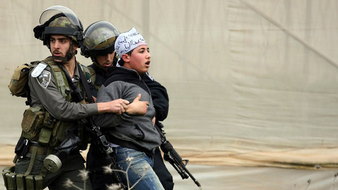 Israeli border police detain a Palestinian demonstrator following clashes at the entrance of the Jalama checkpoint, near the West Bank city of Jenin, on February 22, 2013. (AFP Photo / Saif Dahlah)