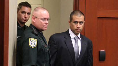 George Zimmerman enters the courtroom for an early appearance. (AFP Photo / Gary W. Green)
