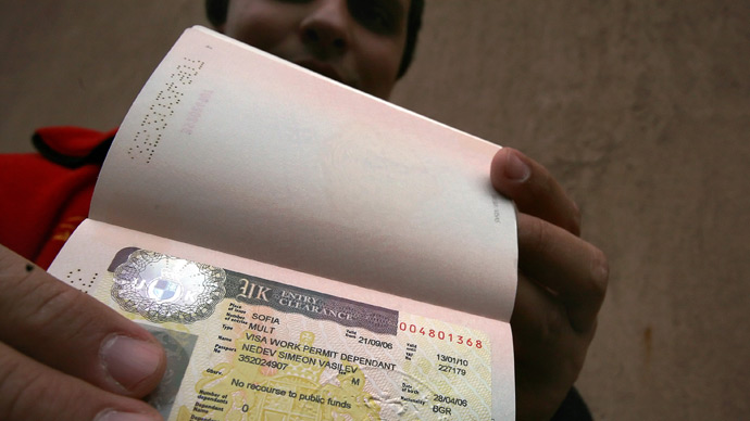 A Bulgarian shows his UK visa in front of the British embassy in Sofia (AFP Photo / Valentina Petrova)