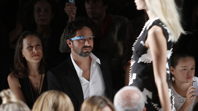 Google founder Sergey Brin and a guest watch the the Diane von Furstenberg Spring/Summer 2013 collection show during New York Fashion Week. (Reuters / Carlo Allegri)