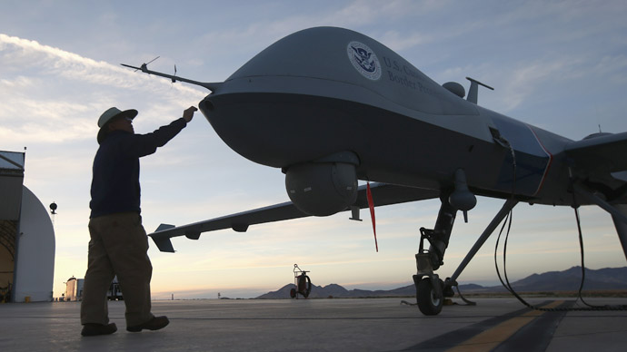Maintenence personel check a Predator drone operated by U.S. Office of Air and Marine (OAM). (John Moore/Getty Images/AFP)