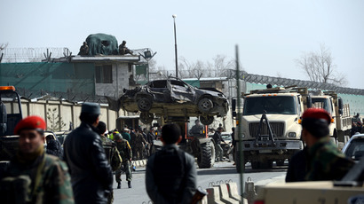 Afghanistan National Army (ANA) soldiers lift a destroyed car as they remove it from the site of a sucide attack next to the ministry of defence main gate in Kabul on March 9, 2013 (AFP Photo / Massoud Hossaini)