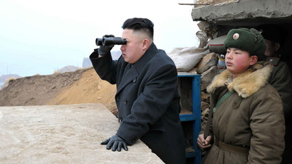 This picture, taken by North Korea's official Korean Central News Agency on March 7, 2013 shows North Korean leader Kim Jong Un (C) using a pair of binocular to look south as he inspects Jangjae Islet Defence Detachment near South Korea's Taeyonphyong Island in South Hwanghae province, North Korea's southwestern sector of the front. (AFP Photo/KCNA via KNS)