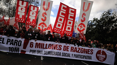 People attend a mass demonstration called by Spain's two main trade unions, CCOO and UGT to protest the country's huge unemployment rate and demand political reform on March 10, 201 in Madrid (AFP Photo / Pedro Armestre)