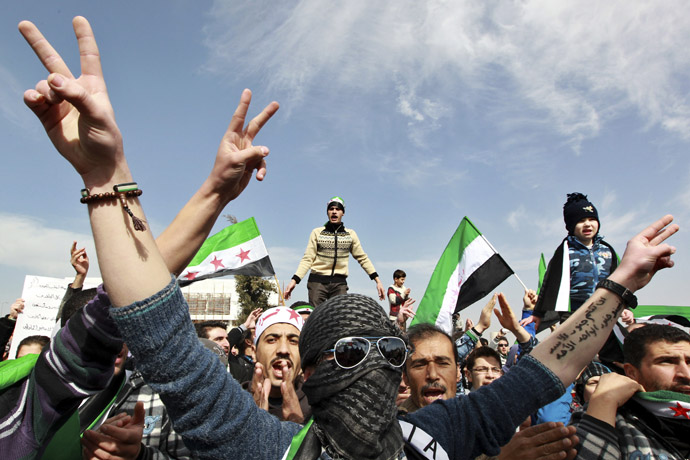 A Syrian living in Jordan flashes the victory sign during a protest against Syrian President Bashar Al-Assad in front of the Syrian Embassy in Amman February 8, 2013. (Reuters/Muhammad Hamed)