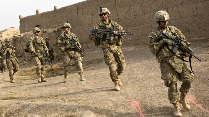 Soldiers from the U.S. Army's Bravo Company, 1st Battalion, 36th Infantry Regiment go on patrol near Command Outpost AJK (short for Azim-Jan-Kariz, a near-by village) in Maiwand District, Kandahar Province, Afghanistan (Reuters/Andrew Burton)