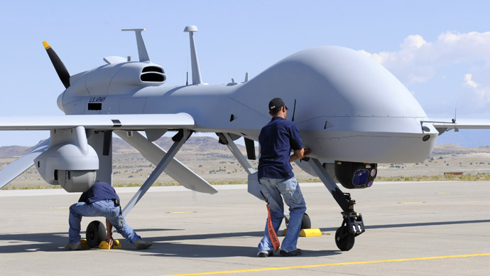 Workers prepare an MQ-1C Gray Eagle unmanned aerial vehicle for static display at Michael Army Airfield, Dugway Proving Ground in Utah (Reuters/U.S. Army/Spc. Latoya Wiggins/Handout)