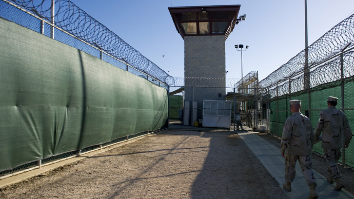 Image by US military: two members of the military walking out of the 'Camp Six' detention facility of the Joint Detention Group at the US Naval Station in Guantanamo Bay, Cuba (AFP Photo/Jim Watson)