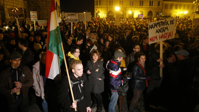 Hungarians attend a demonstration after parliament voted for government-backed constitutional amendments, in Budapest March 11, 2013 Young demonstrators block the entrance of the parliament building as Hungary's ruling party FIDESZ is set to push through changes to the constitution in Budapest March 11, 2013. (Reuters/Bernadett Szabo)