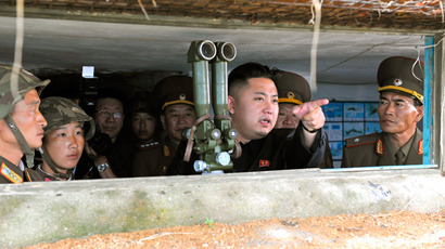 North Korean leader Kim Jong-Un (C) visits a military unit on an island in the most southwest of Pyongyang (Reuters / KCNA)