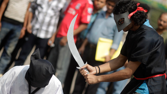 Demonstrators stage a mock beheading to protest the executions in Saudi Arabia (Reuters / Andrew Biraj )