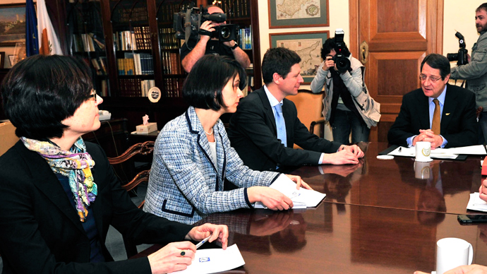 "Representatives from the ""troika"" of lenders, (L-R) the European Central Bank's Isabel von Koppen Mertes, the International Monetary Fund's Delia Velculescu, and the European Commission's Maarten Verwey meet Cyprus President Nicos Anastasiades (R) in Nicosia, March 7, 2013 (Reuters / Yiannis Nisiotis)"