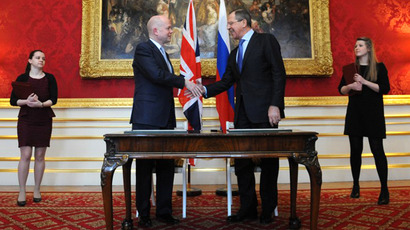 Britain's foreign secretary William Hague shakes hands with Russian foreign minister Sergei Lavrov after signing documents during a joint Britain-Russia foreign and defence ministerial conference, at Lancaster House in London on March 13, 2013. (AFP Photo / Stefan Rousseau)