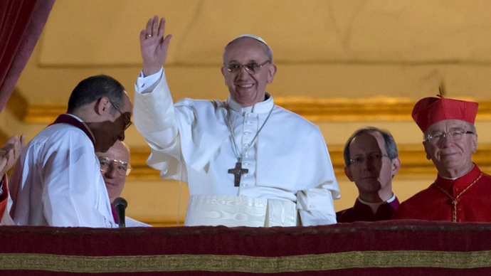 Argentina's Jorge Bergoglio, elected Pope Francis I waves from the window of St Peter's Basilica's balcony after being elected the 266th pope of the Roman Catholic Church on March 13, 2013 at the Vatican. (AFP Photo / Vincenzo Pinto)