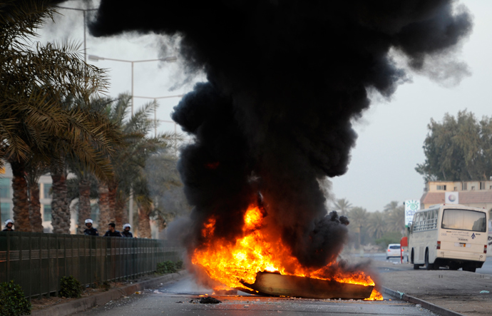 A boat is set on fire by anti-government protesters to act as a road block as riot police arrive to remove it during early hours of clashes in Budaiya, west of Manama March 14, 2013 (Reuters / Hamad I Mohammed)