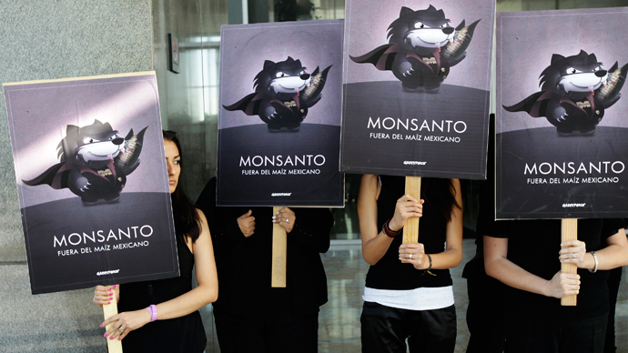 Greenpeace activists hold placards during a demonstration at Monsanto company offices in Mexico City (Reuters / Tomas Bravo)