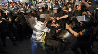 Egyptian demonstrators clash with Egyptian police in central Cairo during a protest to demand the ouster of President Hosni Mubarak and calling for reforms on January 25, 2011. (AFP Photo / Mohammed Abed)