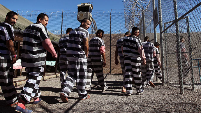 "Undocumented immigrants walk through the Maricopa County ""Tent City Jail"" on April 30, 2010 in Phoenix, Arizona.(AFP Photo / John Moore)"