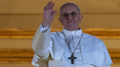 Argentina's Jorge Bergoglio, elected Pope Francis I waves from the window of St Peter's Basilica's balcony after being elected the 266th pope of the Roman Catholic Church on March 13, 2013 at the Vatican.(AFP Photo / Vincenzo Pinto)