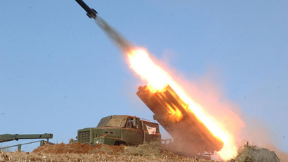 North Korea's artillery sub-units, whose mission is to strike Daeyeonpyeong island and Baengnyeong island of South Korea, conduct a live shell firing drill to examine war fighting capabilities in the western sector of the front line in this picture released by the North's official KCNA news agency in Pyongyang March 14, 2013.(Reuters / KCNA)
