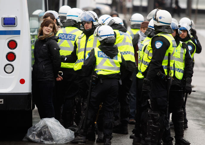 A demonstrator is arrested by police during the annual anti-police brutality march in Montreal, March 15, 2013.(Reuters / Christinne Muschi)