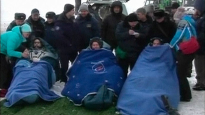 NASA's Kevin Ford (R) of the U.S. and Russian cosmonauts Oleg Novitskiy and Evgeny Tarelkin (L) are seen wrapped in blankets after leaving the Russian Soyuz space capsule following its landing in the steppes of Kazakhstan, northeast of the town of Arkalyk, in this still image taken from video shot on March 16, 2013.(Reuters / NASA)
