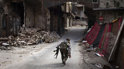 A Syrian rebel crosses a street while trying to dodge sniper fire in the old city of Aleppo in northern Syria.(AFP Photo / Jm Lopez)