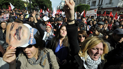 Tunisian people shoot slogans during a demonstration to mark the 40th day of mourning after the death of anti-Islamist opposition leader Chokri Belaid on March 16, 2013.(AFP Photo / Fethi Belaid)