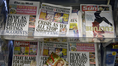 Newspapers are displayed for sale at a newsagents in central London March 17, 2013. (Reuters)