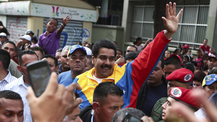 Venezuela's acting President Nicolas Maduro (C) greets supporters during a gathering in Caracas March 16, 2013 in this picture provided by the Miraflores Palace. (Reuters/Miraflores Palace)