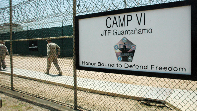 U.S. Navy guards walk inside fencing of Camp VI, the maximum security detention facility for terrorism suspects at the U.S. Naval Base at Guantanamo Bay, Cuba (Reuters/Randall Mikkelsen)