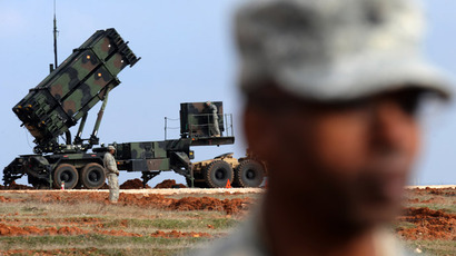 US soldiers stand near a Patriot missile system at a Turkish military base in Gaziantep on February 5, 2013. (AFP Photo/Bulent Kilic)