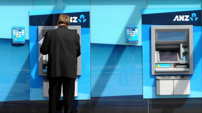 A man withdraws money from an ATM at the global headquarters of the Australia and New Zealand (ANZ) Bank (AFP Photo/William West)