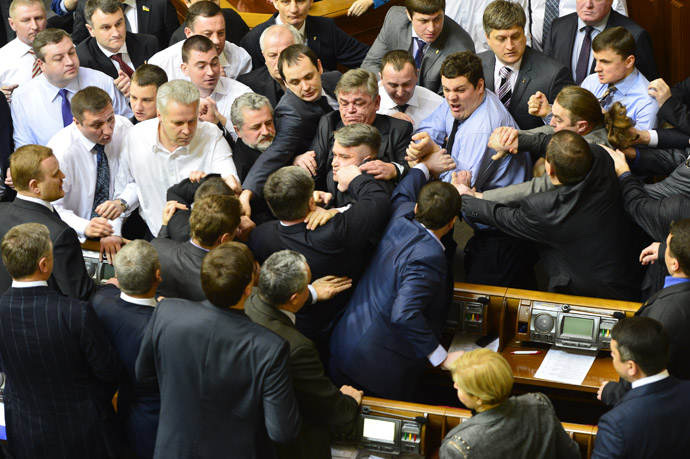 Ukrainian deputies scuffle during a session in the national Parliament in Kiev March 19, 2013. (Reuters)