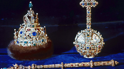 The imperial regalia of Russian Tsar Mikhail Romanov: The Hat of Vladimir Monomakh, scepter and orb featuring gold, precious stones and pearls on display at the Moscow Kremlin's Armory (RIA Novosti)